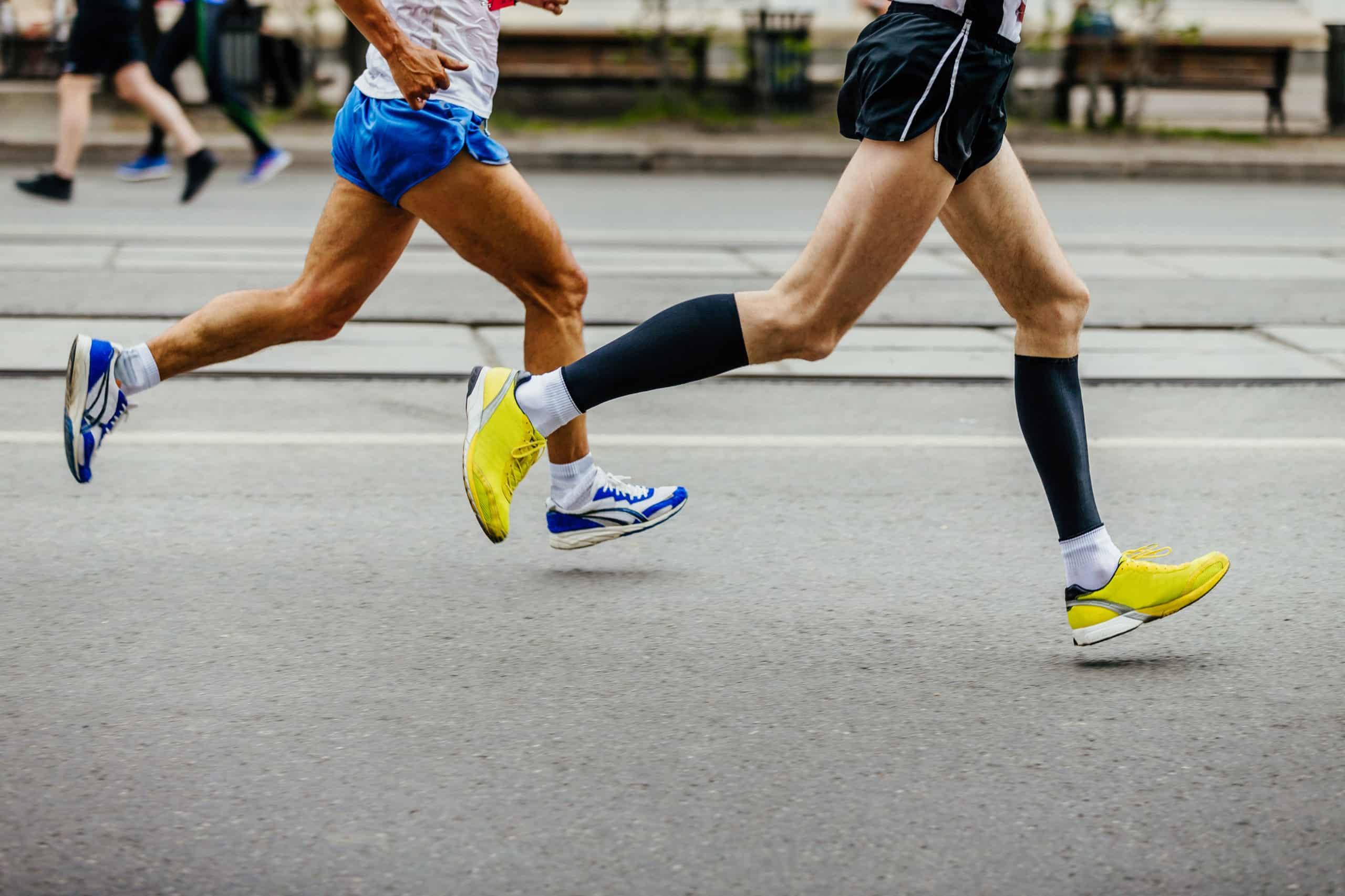 legs of two men runners