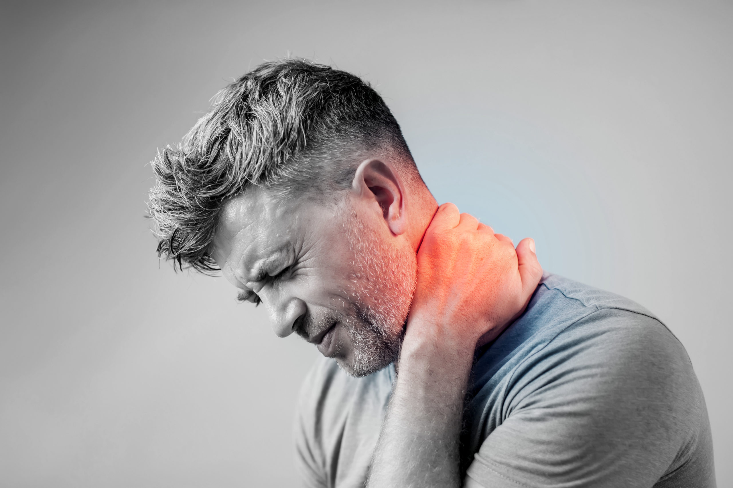 Young man suffering from neck pain. Headache pain.